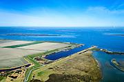 Nederland, Zeeland, Gemeente Schouwen-Duiveland, 01-04-2016; Brouwershaven, Grevelingenmeer. Werkhaven Bommenede, gebruikt voor bouw caissons die nodig waren bij de aanleg van de Brouwersdam (links aan de horizon).<br /> <br /> luchtfoto (toeslag op standard tarieven);<br /> aerial photo (additional fee required);<br /> copyright foto/photo Siebe Swart