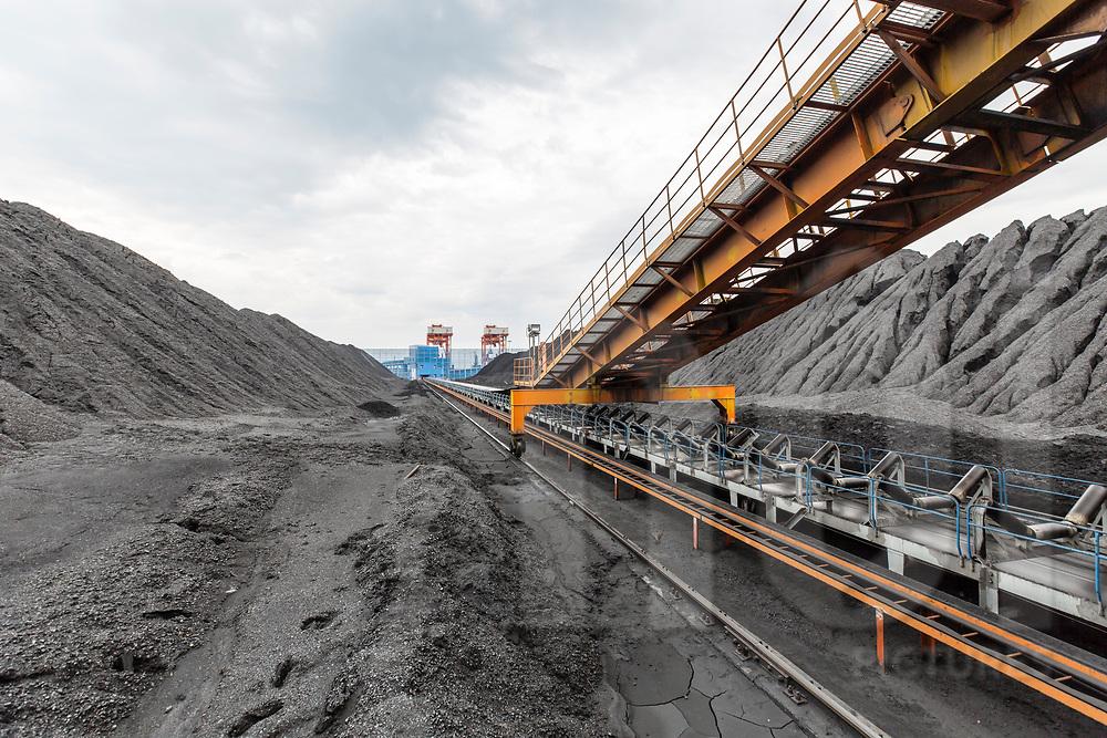 Conveyor belt goes through a coal storage plant. EVN Genco 3, Vinh Tan, Vietnam, Southeast Asia