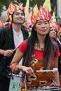 Samba drummers from Extinction Rebellion arrive in Trafalgar Square during the first day of Impossible Rebellion protests on 23rd August 2021 in London, United Kingdom. Extinction Rebellion are calling on the UK government to cease all new fossil fuel investment with immediate effect.