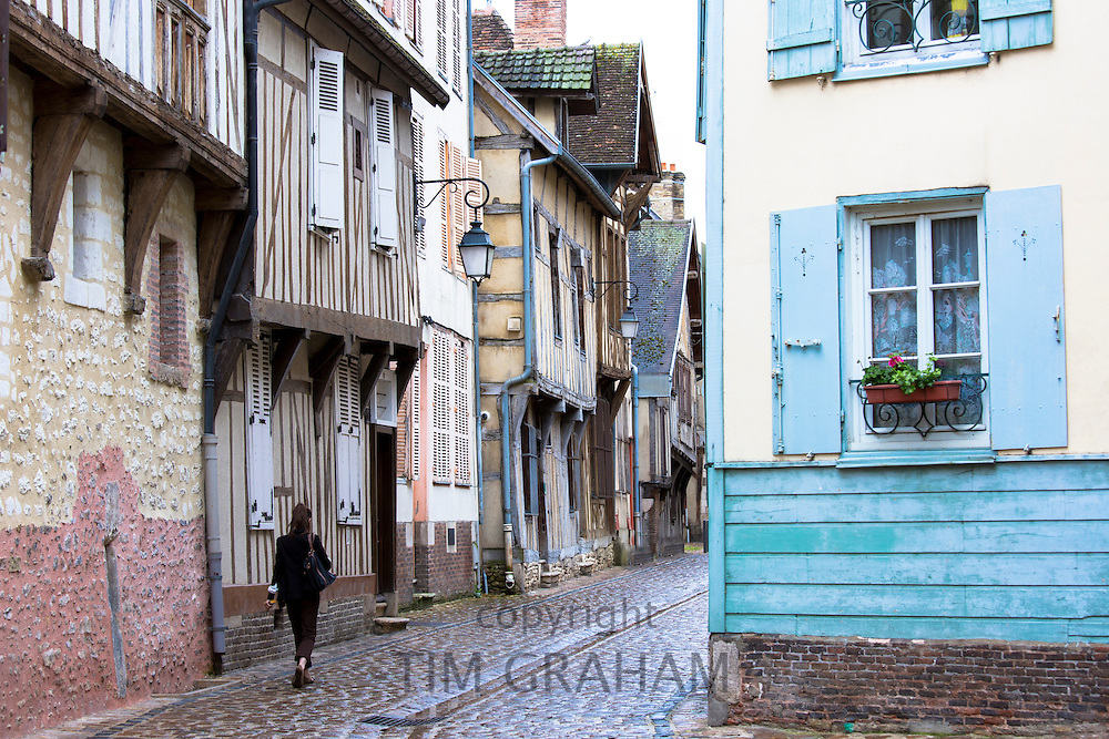 Traditional medieval timber-frame architecture and narrow cobbled street at Troyes in the Champagne-Ardenne region of France