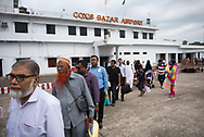 Passengers move in line to board a flight to Dhaka at Cox's Bazar airport in Bangladesh