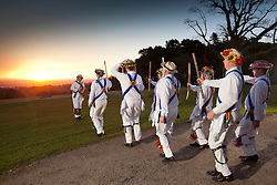 "© Licensed to London News Pictures. 1/4/2013. Birmingham, UK. To welcome in the first day of May in traddititional style, the Jockey Morris men of Birmingham paid an inaugural visit to the highest point in Birmingham, Lickey Hills Country Park to ""dance in the dawn"". The Jockey Morris Men were formed in 1949, by it is believed a woman called Gwen Johnson who lived in Jockey Road, the rosettes are from the Sutton Rose motif and the Blue Baldricks are from the colour associated with Birmingham. The Lickey Hills Country park overlooks Longbridge and the city of Birmingham. Photo credit : Dave Warren/LNP"