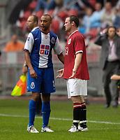 Photo: Daniel Hambury.<br />Manchester United v FC Porto. Amsterdam Tournament. <br />04/08/2006.<br />Manchester's Wayne Rooney ask why he was sent off to  Porto's Tarik Sektioui.
