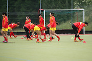 The Chinese team warms up before their match against Australia in the Investec Hockey World League Semi Final 2013, the Quintin Hogg Memorial Sports Ground, University of Westminster, London, UK on 27 June 2013. Photo: Simon Parker
