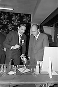 22/10/1963<br /> 10/22/1963<br /> 22 October 1963<br /> R.D.S. Scientific Exhibition opens, Ballsbridge, Dublin. Queen's University Belfast Chemistry stand at the exhibition. Minister for Education Patrick Hillery, looking over the Queen's Department of Analytical Chemistry stand with Dr. Salah Shahine (Egypt), Research Chemist.