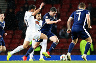 Scotland defender Scott McKenna (5) (Aberdeen) moves the ball out of defence during the UEFA Nations League match between Scotland and Israel at Hampden Park, Glasgow, United Kingdom on 20 November 2018.