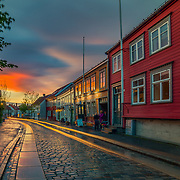Bakklandet is a neighborhood of Trondheim, Norway. It lies on the east side of the river Nidelva between Bakke Bridge and the Old Town Bridge. The area is dominated by small, wooden houses and narrow streets. It is among the major tourist attractions in the city.