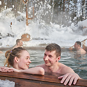 """People enjoy a hotspring along the northern shore at Russia's Lake Baikal, near Severobaikalsk. Crowned the """"Jewel of Siberia"""", Baikal is the world's deepest lake, and the biggest lake by volume, holding 20% of the world's fresh water. In the winter, the lake 31,722 square meter surface is entirely frozen with ice averaging 2 meters thick."""