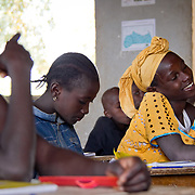 Enjoying class in Koumbadiouma's primary school. Kolda, Senegal.