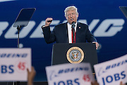 U.S. President Donald Trump addresses employees at the debut of the new Boeing 787-10 Dreamliner aircraft at the Boeing factory February 17, 2016 in North Charleston, SC. The visit comes two days after workers at the South Carolina plant voted to reject union representation in a state where Trump won handily.