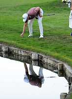 Golf - 2019 BMW PGA Championship - Thursday, First Round<br /> <br /> Danny Willett after going in the water at the 18th hole, at the West Course, Wentworth Golf Club.<br /> <br /> COLORSPORT/ANDREW COWIE