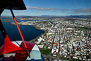 An aerial view of the city of Reykjavik, Iceland from a Pitts Special biplane.