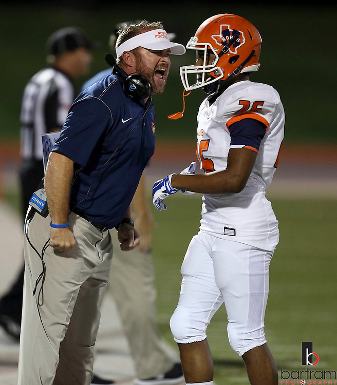 North head coach Mike Fecci talks to Caprice Carson on the sideline during a game between McKinney North and Wylie High School on Friday, Aug. 26, 2016 in Wylie, Texas. (Kevin Bartram/www.buzzzphotos.com)