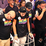KISSIMMEE, FL - JULY 15: Members of the crowd pause for a moment of silence prior to the Orlando Cruz versus Alejandro Valdez boxing match at the Kissimmee Civic Center on July 15, 2016 in Kissimmee, Florida. Cruz was the first professional boxer to announce himself as gay and recently lost four friends in the Pulse Nightclub shooting in Orlando, he dedicated this match to his lost friends and won the bout by TKO in the 7th round.  (Photo by Alex Menendez/Getty Images) *** Local Caption *** Orlando Cruz; Alejandro Valdez