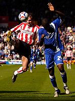 Photo: Alan Crowhurst.<br />Southampton v Cardiff City. Coca Cola Championship. 01/04/2006. Cardiff's Guylain Ndumbu-Nsungu (R) with Claus Lundekvam.