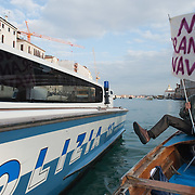 VENICE, ITALY - JANUARY 16:  A Police power boats tries to stop a boat with protesters on the day of the special meeting discussing the environmental impact of cruises in St Mark's basin on January 16, 2012 in Venice, Italy. Protest are mounting in Venice against large cruise ships crossing St Marks's basin after the Costa Concordia tragedy