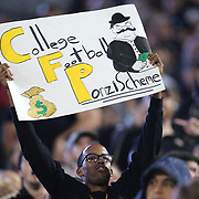 A UCF fan holds up a sign during a NCAA football game between the University of South Florida Bulls and the UCF Knights at Spectrum Stadium on Friday, November 24, 2017 in Orlando, Florida. (Alex Menendez via AP)