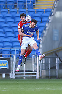Nottingham Forest's Scott McKenna (26) competes for a high ball with Cardiff City's Kieffer Moore (10) during the EFL Sky Bet Championship match between Cardiff City and Nottingham Forest at the Cardiff City Stadium, Cardiff, Wales on 2 April 2021.