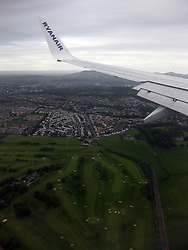 Photographs onboard an early morning Ryanair flight on it's approach over Edinburgh, on the way to land at Edinburgh airport,a day after the latest Iceland volcano dust scare.
