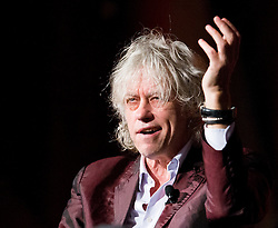 © Licensed to London News Pictures. 24/07/2014. Musician and Campaigner Sir Bob Geldof makes a funny gesture during a session of the 20th International AIDS conference held in Melbourne Australia. Photo credit : Asanka Brendon Ratnayake/LNP