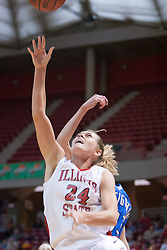 26 February 2006:  Amber Shelton slips past Angie Janis.....Illinois State Redbirds out muscled the Creighton Bluejays on Senior day by a score of 75-61.  Senior Holly Hallstorm grabbed her 10th double double with 20 points and 12 rebounds.  Competition took place at Redbird Arena on Illinois State University campus in Normal Illinois.