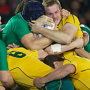 Pat McCabe, Australia, is tackled during the Australia V Ireland Pool C match during the IRB Rugby World Cup tournament. Eden Park, Auckland, New Zealand, 17th September 2011. Photo Tim Clayton...