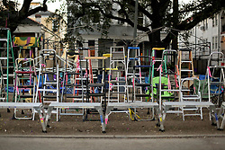 09 February 2016. New Orleans, Louisiana.<br /> Mardi Gras Day. Waiting for the parade. Ladders lined up along the main Mardi Gras parade route of Zulu and Rex on St Charles Avenue.<br /> Photo©; Charlie Varley/varleypix.com