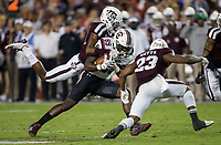 South Carolina wide receiver Bryan Edwards (89) is tackled by Texas A&M defensive back Myles Jones (10) and defensive back Armani Watts (23) after picking up a first down during the second quarter of an NCAA college football game Saturday, Sept. 30, 2017, in College Station, Texas. (AP Photo/Sam Craft)