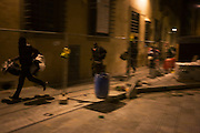 Illegal African street hawkers escape from Carabinieri in Florence's Via di Corti.