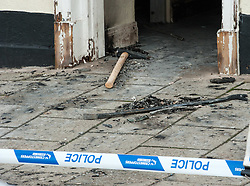 © Licensed to London News Pictures. 28/10/2015. Thornbury, South Gloucestershire, UK. A suspected raid on Barclays Bank in Thornbury High Street occurred at 3.30am.  An ATM in a foyer corridor with 24 hrs access was targeted, and an explosion damaged the interior.  A gas bottle can be seen in the foyer corridor and a large hammer and crowbar were left at the scene. Photo credit : Simon Chapman/LNP