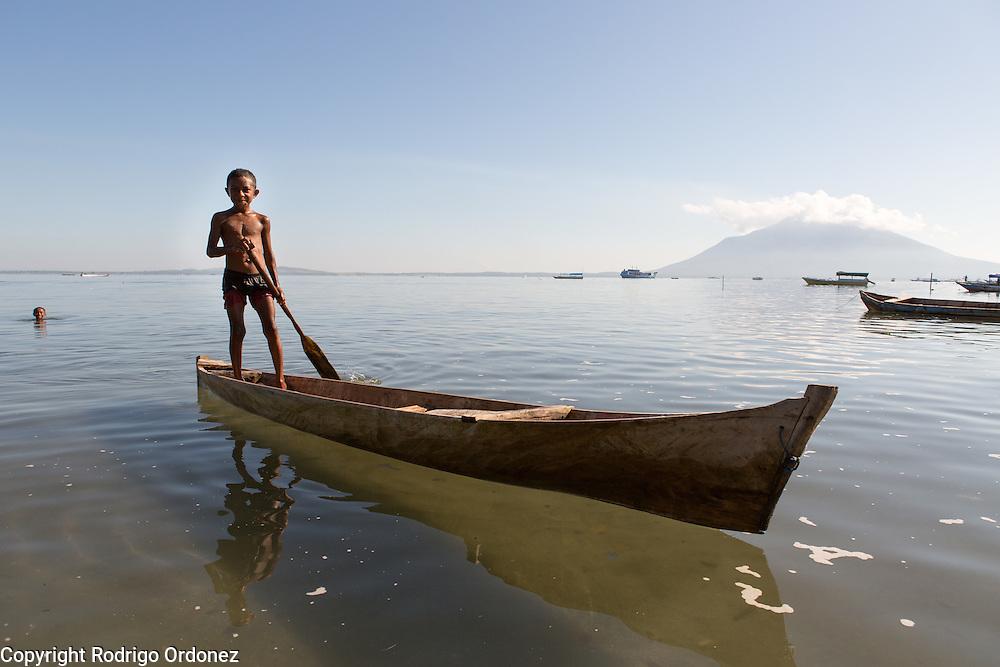 Yakob, 9, paddles a fisherman boat in Lewoleba, Nubatukan subdistrict, Lembata district, East Nusa Tenggara province, Indonesia.