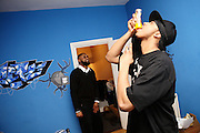 Iron Braydz, 26, (right) is having honey before leaving home to perform while Cataclysm, 27, (left) is waiting to leave with him, in Willesden, London, on Thursday, Feb. 15, 2007. Islamic Hip Hop artists like the duo 'Blind Alphabetz', from London, feel more than ever the need to say what they think aloud. In the music industry the backlash of a disputable Western foreign policy towards Islamic countries and its people is strong. The number of artists in the European Union and the US taking this into consideration and addressing the current social and political problems within their lyrics is growing rapidly and fostering awareness for Muslim and others alike.