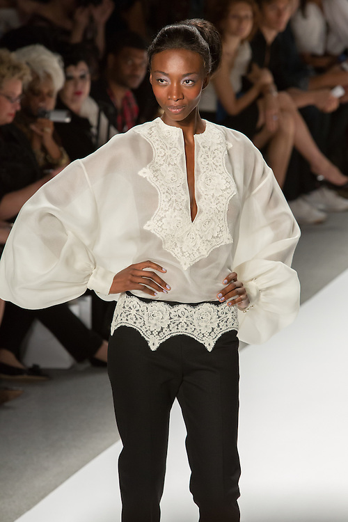 Black trousers with lace at the waist, and a white lace top. By Zang Toi, shown at his Spring 20132 Fashion Week show in New York.