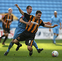 Photo: Pete Lorence.<br />Coventry City v Hull City. Coca Cola Championship. 03/03/2007.<br />Michael Doyle tackles Nicky Forster.