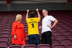 Edinburgh, Scotland, UK. 2 August 2019. Conductor Gustavo Dudamel at Tynecastle Stadium in Edinburgh to conduct the LA Philharmonic Orchestra at the Aberdeen Standard Investments opening Event of the Edinburgh International Festival. Pictured. Ann Budge, owner of Hearts, Gustavo Dudamel, Fergus Linehan. Iain Masterton/Alamy Live News ++ Editorial Use Only ++