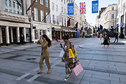 Exclusive, high end fashion shopping district on Bond Street is open for business with some shoppers about, but incredibly quiet under coronavirus lockdown on 26th June 2020 in London, England, United Kingdom. As the July deadline approaces and government will relax its lockdown rules further, the West End remains quiet, while some non-essential shops are allowed to open with individual shops setting up social distancing systems.