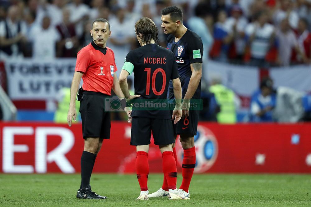 (l-r) referee Mark Geiger, Luka Modric of Croatia, Dejan Lovren of Croatia during the 2018 FIFA World Cup Russia Semi Final match between Croatia and England at the Luzhniki Stadium on July 01, 2018 in Moscow, Russia