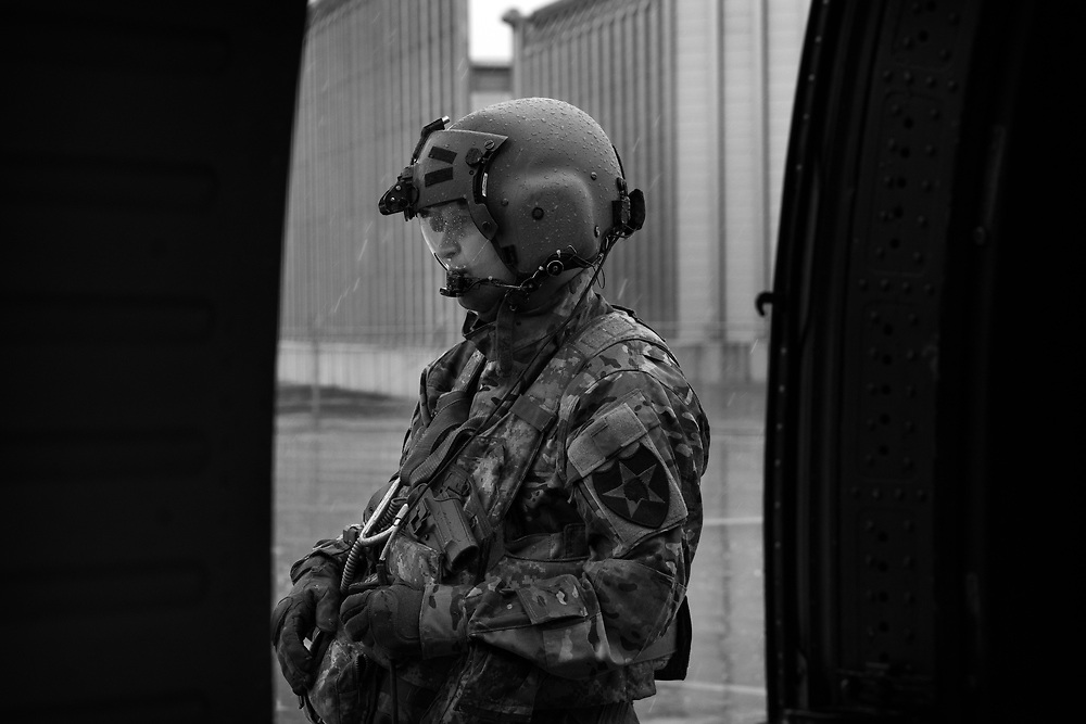 A Flight Medic does his run-up checks in the rain at 40F.