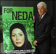 Atlanta  - Documentary director  Anthony Thomas stands beside a poster Neda at the Carter Center on Friday, June 11, 2010.  He directed the documentary on her that will be shown on HBO.    On June 20, 2009, Neda Agha-Soltan was shot and killed on the streets of Tehran during the turmoil that followed the Iranian presidential context. Within hours images of her dying moments, captured on cell phones, appeared on computer screens across the world, focusing the world?s attention on mass protests against the rigged election in Iran. Neda risked her life in the cause of freedom. © 2010 Johnny Crawford
