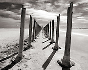 Wood supports are all that remain from a dock that once stood on the north shore of the Great Salt Lake in Utah. The falling water level, which has been taking place for millions of years, will eventually turn the lake into an area much like the Bonneville Salt Flats in western Utah.