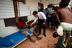 France's President Emmanuel Macron talks with residents during his visit in the French Caribbean islands of St. Martin, Tuesday, Sept. 12, 2017. Macron is in the French-Dutch island of St. Martin, where 10 people were killed on the French side and four on the Dutch. Photo by Christophe Ena/Pool/ABACAPRESS.COM