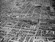 Y-480125-02.  Center St. yards. Holgate overpass is center of photo, looking east. On right PT Co. yards. On left SP Roundhouse. January 25, 1948