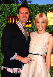 File photo dated October 9, 2011 of Kyle Newman and Jaime King attend the Veuve Clicquot Polo Classic held at Will Rogers State Historic Park in Los Angeles, CA, USA. Jaime King is getting a divorce from her husband of nearly 13 years, director Kyle Newman. According to People, the 41-year-old actor also filed a domestic violence prevention petition in Los Angeles on Monday. Photo by Lionel Hahn/ABACAPRESS.COM