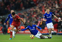 Everton's Idrissa Gueye (centre) and Liverpool's Cameron Brannagan battle for the ball during the Premier League match at Anfield, Liverpool.