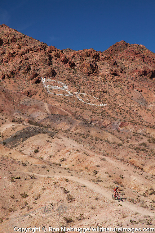 Mountain biking on the trails at Bootleg Canyon Mountain Bike Park, Boulder City, Nevada (model released)