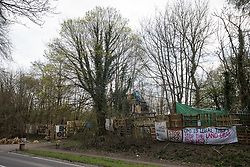 Wendover, UK. 9th April, 2021. Wendover Active Resistance Camp, which is occupied by anti-HS2 activists, is pictured opposite a site across the A413 where trees are currently been felled for the HS2 high-speed rail link. Tree felling work for the project is now taking place at several locations between Great Missenden and Wendover in the Chilterns AONB, including at Jones Hill Wood.