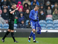 Leicester City's James Maddison celebrates scoring his side's first goal of the game and reveals a t-shirt that reads 'RIP Sophie I Love You' before being booked by match referee Michael Oliver (left) for removing his shirt during the Premier League match at Turf Moor, Burnley.