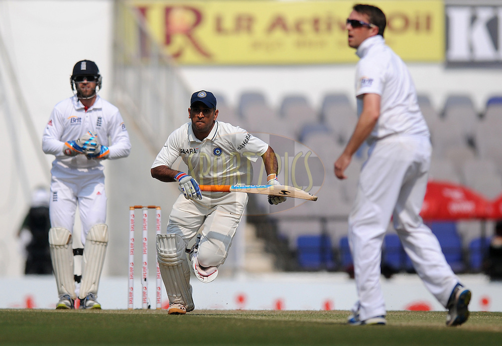 MS Dhoni captain of India runs between the wicket during day three of the 4th Airtel Test Match between India and England held at VCA ground in Nagpur on the 15th December 2012..Photo by  Pal Pillai/BCCI/SPORTZPICS .