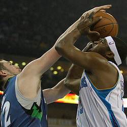 08 February 2009:  Minnesota Timberwolves forward Kevin Love (42) blocks a shot by New Orleans Hornets guard Devin Brown (23) during a NBA game between the Minnesota Timberwolves and the New Orleans Hornets at the New Orleans Arena in New Orleans, LA.