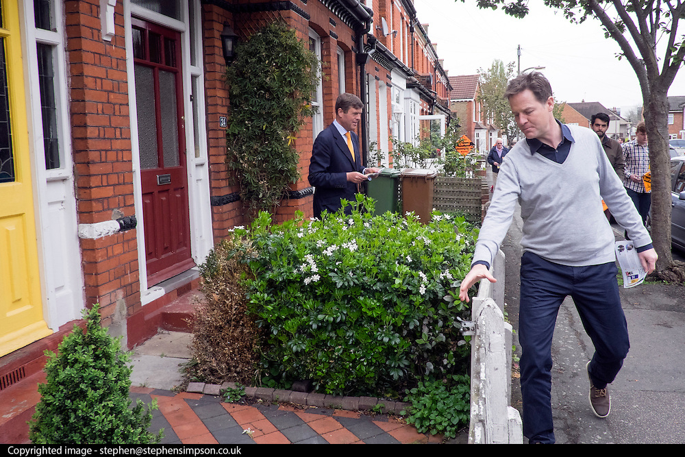 © Licensed to London News Pictures. 26/04/2015. Sutton, UK PAUL BURSTOW AND NICK CLEGG leaflet Orchard Road in Sutton. Deputy Prime Minister and Leader of the Liberal Democrats Nick Clegg makes a speech today, 26th April 215 in Sutton, to local Liberal Democrats in support of the candidate for Sutton and Cheam, Paul Burstow. Nick Clegg and Paul Burstow also joined local campaigners to deliver leaflets on a nearby street, and put up a Liberal Democrat stakeboard.. Photo credit : Stephen Simpson/LNP